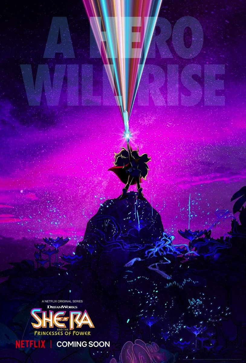 She-Ra in silhouette with glowing blonde hair and red cape stands on a rock. She holds her sword aloft, and its jewel sparkles. -- A hero will rise. She-Ra and the Princesses of Power