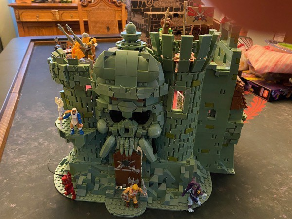 The front of Castle Grayskull Mega Construx set with two towers, huge skull wall, and the jawbridge.