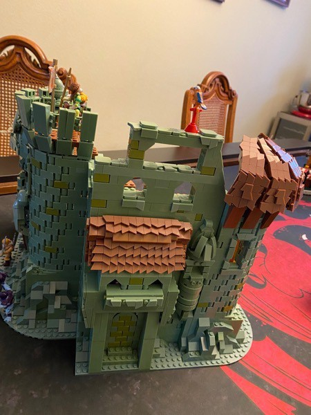The side/back wall of Castle Grayskull, complete with tiled and curved roofs, windows, etc.