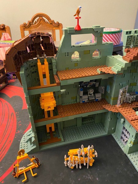 Inside the side/back wall of Castle Grayskull with computer console and working elevator.